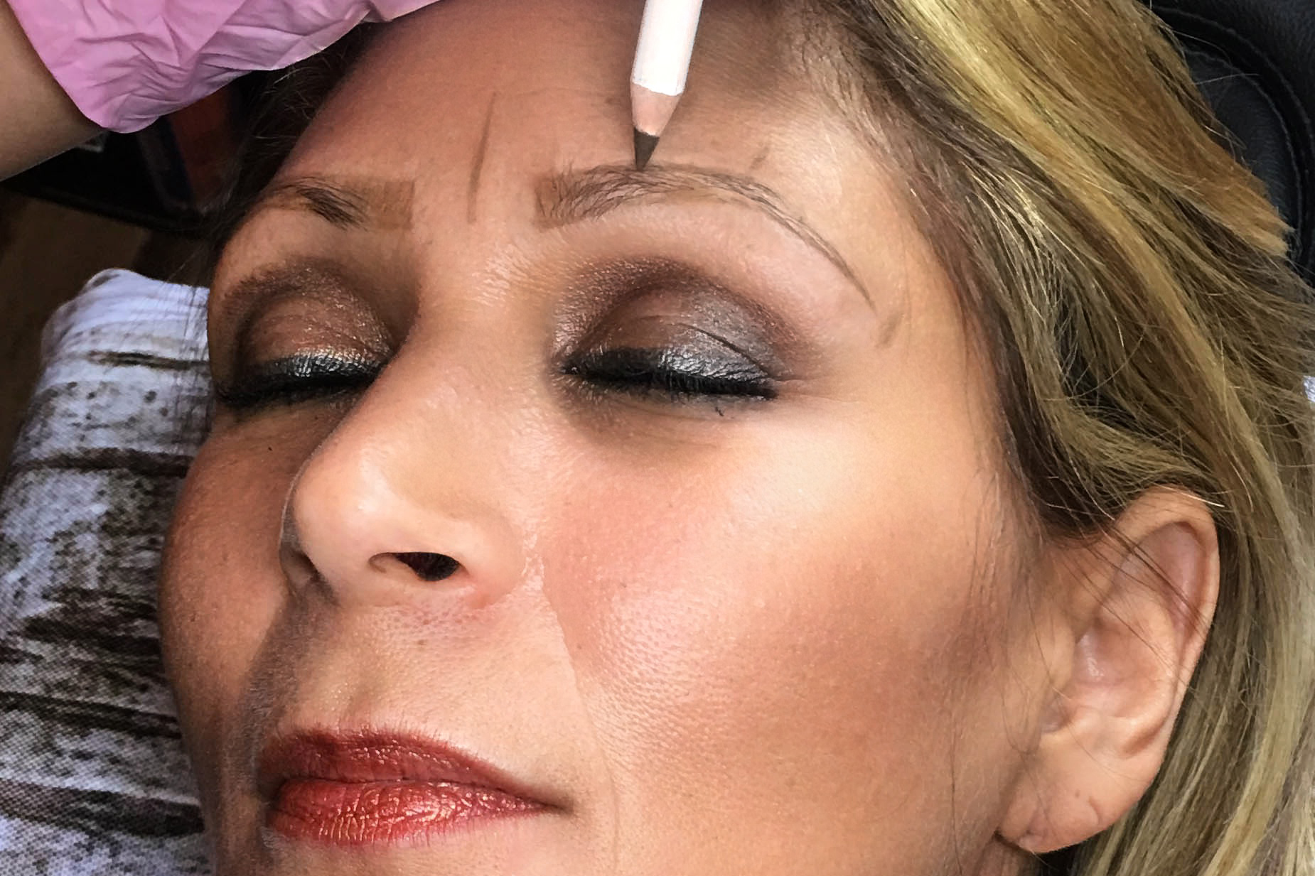 Drawing eyebrows at our microblading in Orlando salon