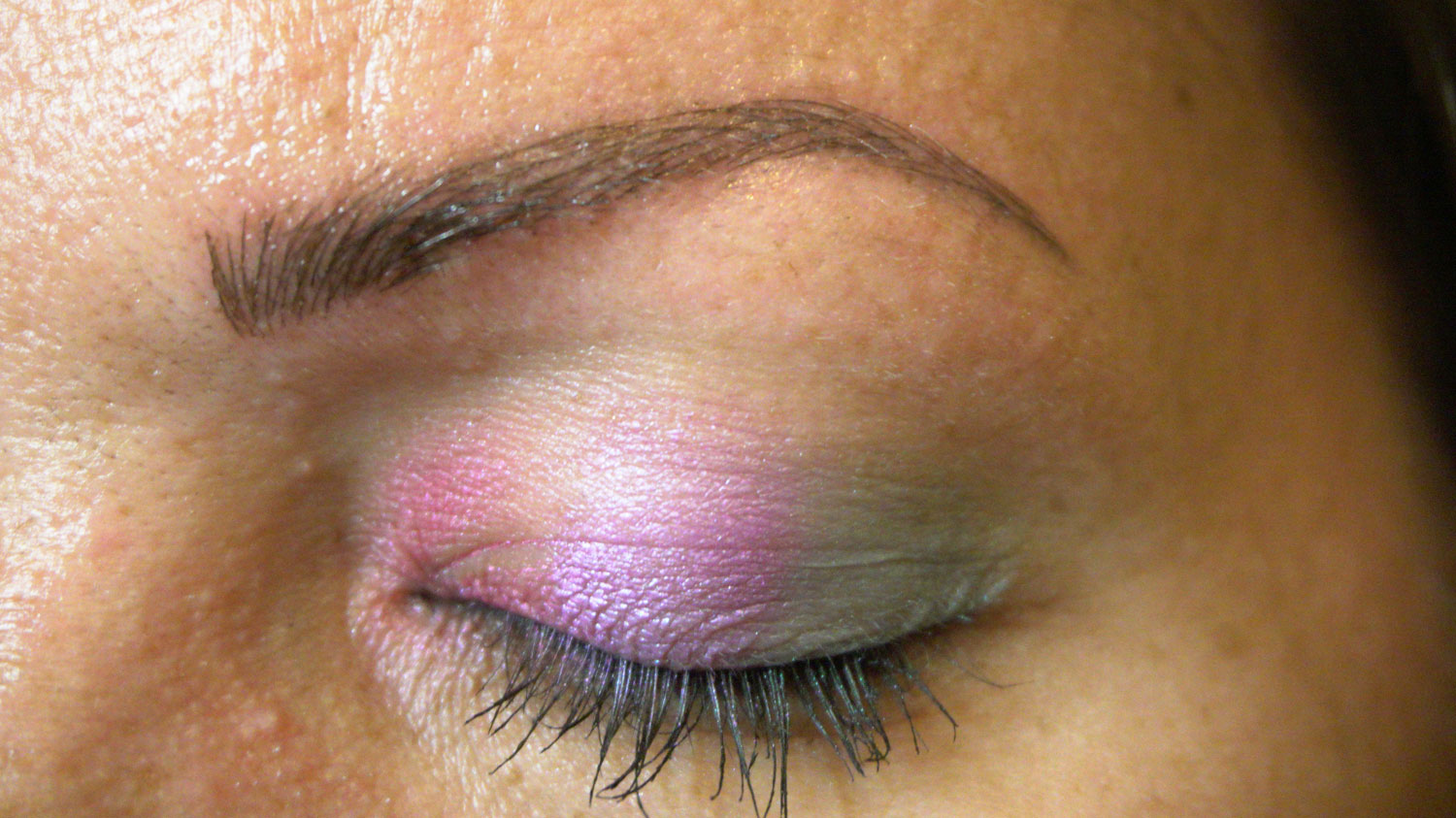 closeup of permanent makeup microblade eyebrow after procedure