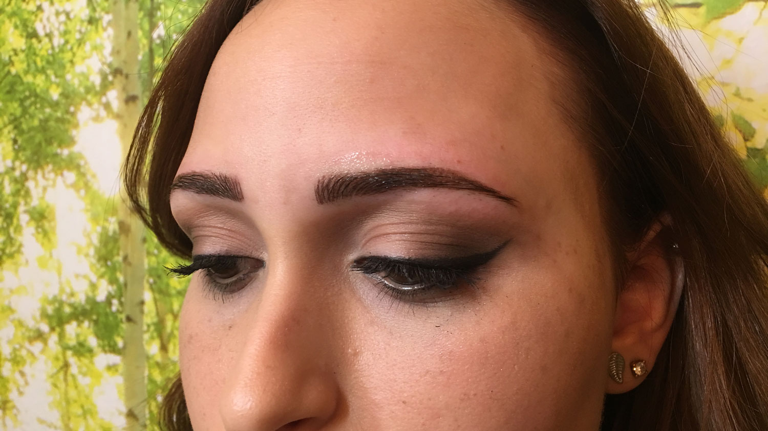 A closeup of a young womans eyebrows after Orlando microblading permanent makup procedure